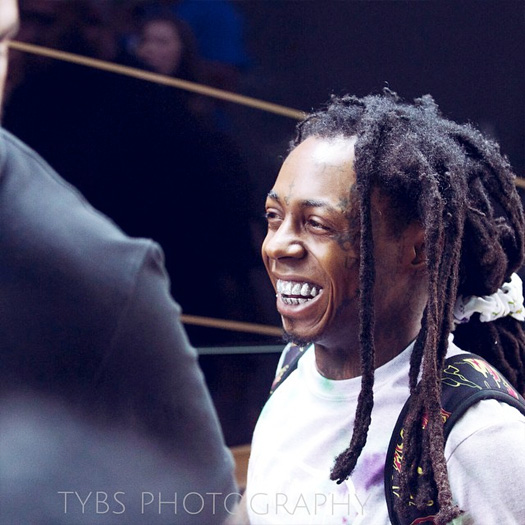 Lil wayne spotted exiting the ritz carlton hotel in charlotte signs