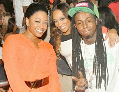 Trina and Lil Wayne together at LIV Nightclub